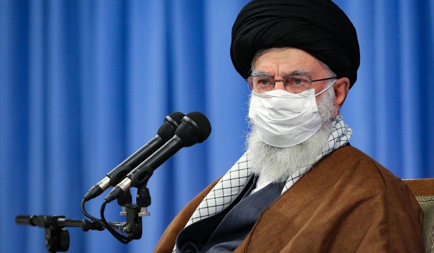 In this picture released by the official website of the office of the Iranian supreme leader, Supreme Leader Ayatollah Ali Khamenei, wearing a mask to protect against COVID-19,  attends a meeting with National Corona Headquarters, in Tehran, Iran, Saturday, Oct. 24, 2020. (Office of the Iranian Supreme Leader via AP)