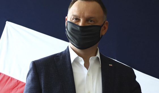 File—File picture taken June 28, 2020 shows Poland's President Andrzej Duda casting his vote during presidential election in Krakow, Poland. Duda was tested positive on Corona. (AP Photo/Beata Zawrzal, file)