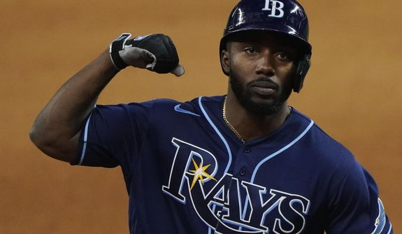 Tampa Bay Rays' Randy Arozarena celebrates a home run against the Los Angeles Dodgers during the fourth inning in Game 4 of the baseball World Series Saturday, Oct. 24, 2020, in Arlington, Texas. (AP Photo/Tony Gutierrez)