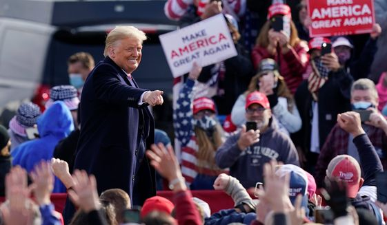 "President Trump is running with a fundraising disadvantage against Democratic presidential nominee Joseph R. Biden, who is pulling in ""dark money"" from big donors. The Trump campaign, meanwhile, is focusing on an extensive ground operation. (Associated Press/File)"