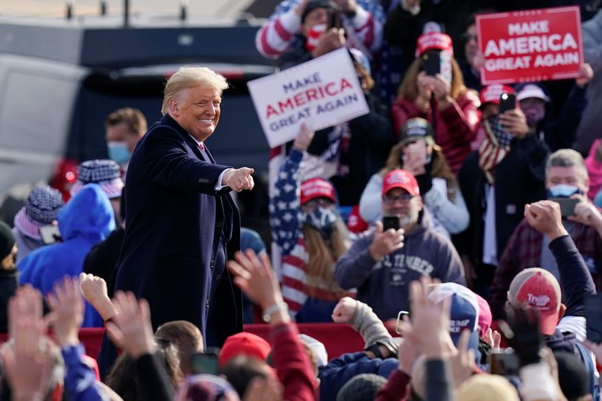 """President Trump is running with a fundraising disadvantage against Democratic presidential nominee Joseph R. Biden, who is pulling in """"dark money"""" from big donors. The Trump campaign, meanwhile, is focusing on an extensive ground operation. (Associated Press/File)"""