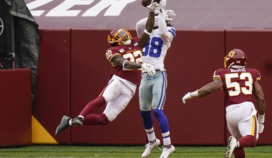 Washington Football Team safety Deshazor Everett (22) stops Dallas Cowboys wide receiver CeeDee Lamb (88) from making a catch in the endzone in the first half of an NFL football game, Sunday, Oct. 25, 2020, in Landover, Md. Also on the field is Washington Football Team inside linebacker Jon Bostic (53).(AP Photo/Patrick Semansky)