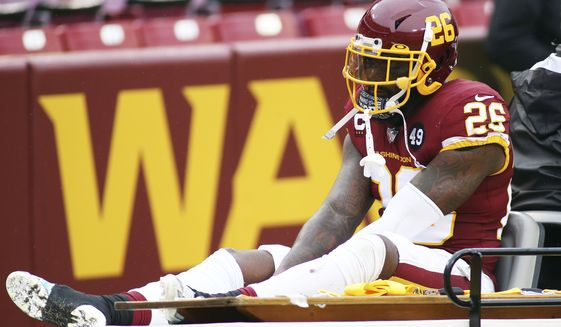 Washington Football Team strong safety Landon Collins (26) gets carted off the field due to an injury during an NFL football game against the Dallas Cowboys, Sunday, Oct. 25, 2020 in Landover, Md. (AP Photo/Daniel Kucin Jr.)