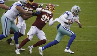 Dallas Cowboys quarterback Ben DiNucci (7) is tackled by Washington Football Team defensive end Ryan Kerrigan (91) in the second half of an NFL football game, Sunday, Oct. 25, 2020, in Landover, Md. Washington won 25-3. (AP Photo/Al Drago)