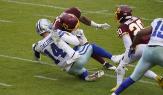 Dallas Cowboys quarterback Andy Dalton (14) is hit by Washington Football Team inside linebacker Jon Bostic (53) in the second half of an NFL football game, Sunday, Oct. 25, 2020, in Landover, Md. Dalton left the field after this play and Bostic was ejected from the game. (AP Photo/Patrick Semansky)