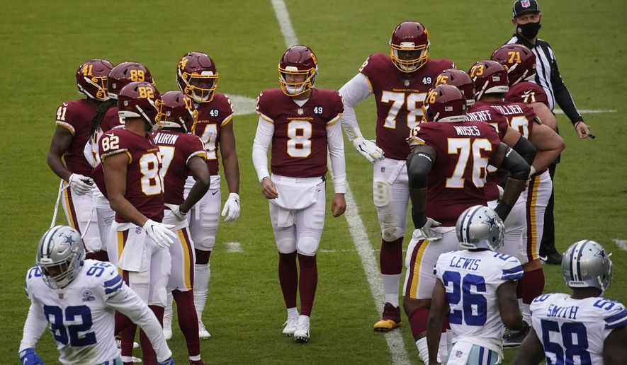 Washington Football Team quarterback Kyle Allen (8) before the start of the first half of an NFL football game against Dallas Cowboys, Sunday, Oct. 25, 2020, in Landover, Md. (AP Photo/Al Drago)