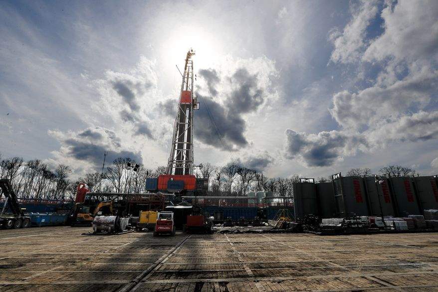 In this March 12, 2020, file photo, the sun shines through clouds above a shale gas drilling site in St. Mary's, Pa. In a late gambit to win the battleground state of Pennsylvania, President Donald Trump and his GOP allies have intensified attacks on Joe Biden over fracking, hoping to drive a wedge between the former vice president and the white, working-class voters tied to the state's booming natural gas industry. (AP Photo/Keith Srakocic, File)