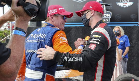 Josef Newgarden, right, congratulates Scott Dixon on the NTT IndyCar Series Championship following an IndyCar auto race Sunday, Oct. 25, 2020, in St. Petersburg, Fla. (AP Photo/Mike Carlson)