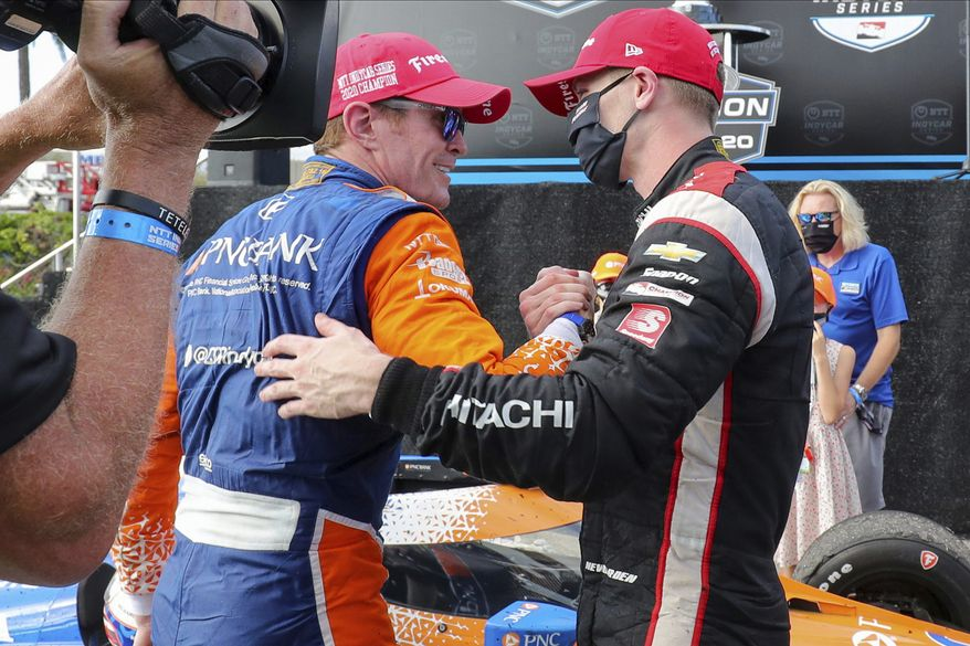Josef Newgarden, right, congratulates Scott Dixon on the NTT IndyCar Series Championship following an IndyCar auto race Sunday, Oct. 25, 2020, in St. Petersburg, Fla. (AP Photo/Mike Carlson)