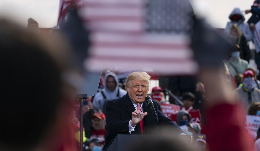 President Donald Trump speaks at a campaign rally at Manchester-Boston Regional Airport, Sunday, Oct. 25, 2020, in Londonderry, N.H. (AP Photo/Alex Brandon)