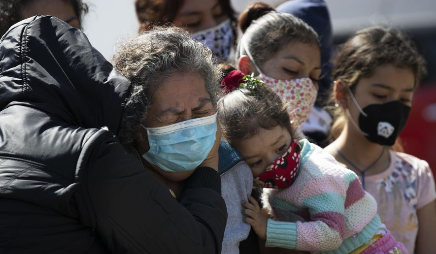 """Relatives bury Isaac Nolasco who died of reasons not believed related to COVID-19, in a section of the municipal cemetery Valle de Chalco amid the new coronavirus pandemic, on the outskirts of Mexico City, Sunday, Oct. 25, 2020. Mexican families traditionally flock to local cemeteries to honor their dead relatives as part of the """"Dia de los Muertos,"""" or Day of the Dead celebrations, but according to authorities, the cemeteries will be closed this year to help curb the spread of COVID-19. (AP Photo/Marco Ugarte)"""
