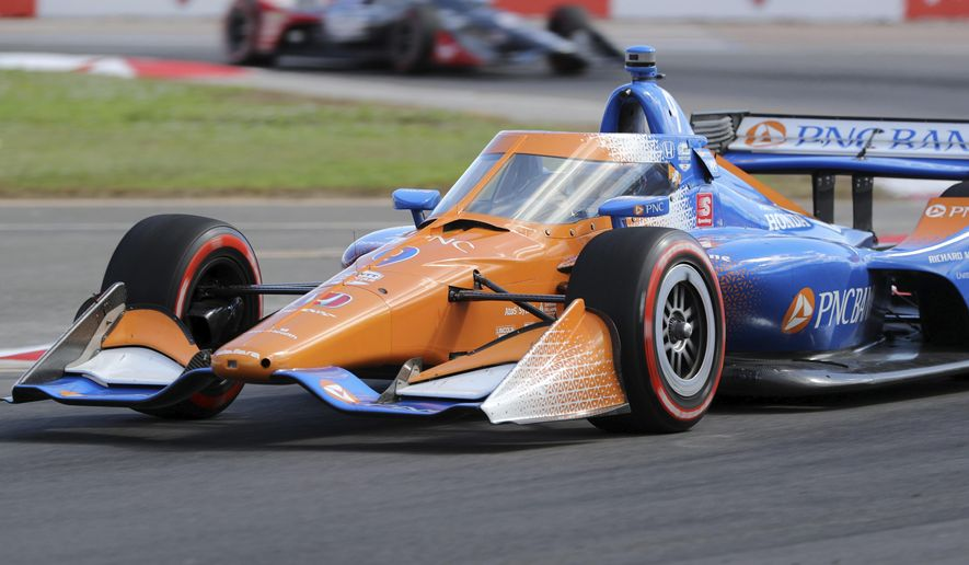 Scott Dixon drives into turn two during the IndyCar auto race Sunday, Oct. 25, 2020, in St. Petersburg, Fla. (AP Photo/Mike Carlson)