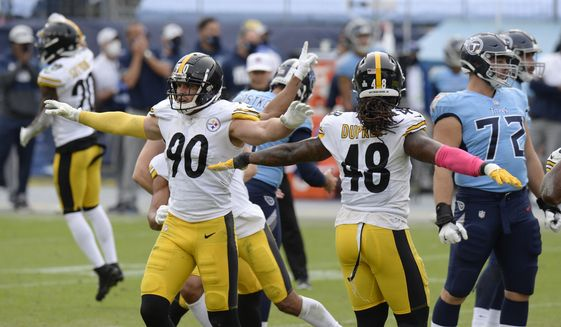 Pittsburgh Steelers outside linebackers T.J. Watt (90) and Bud Dupree (48) celebrate after a 45-yard field goal attempt by Tennessee Titans kicker Stephen Gostkowski was no good in the final seconds of the fourth quarter in an NFL football game Sunday, Oct. 25, 2020, in Nashville, Tenn. The Steelers won 27-24. (AP Photo/Mark Zaleski)