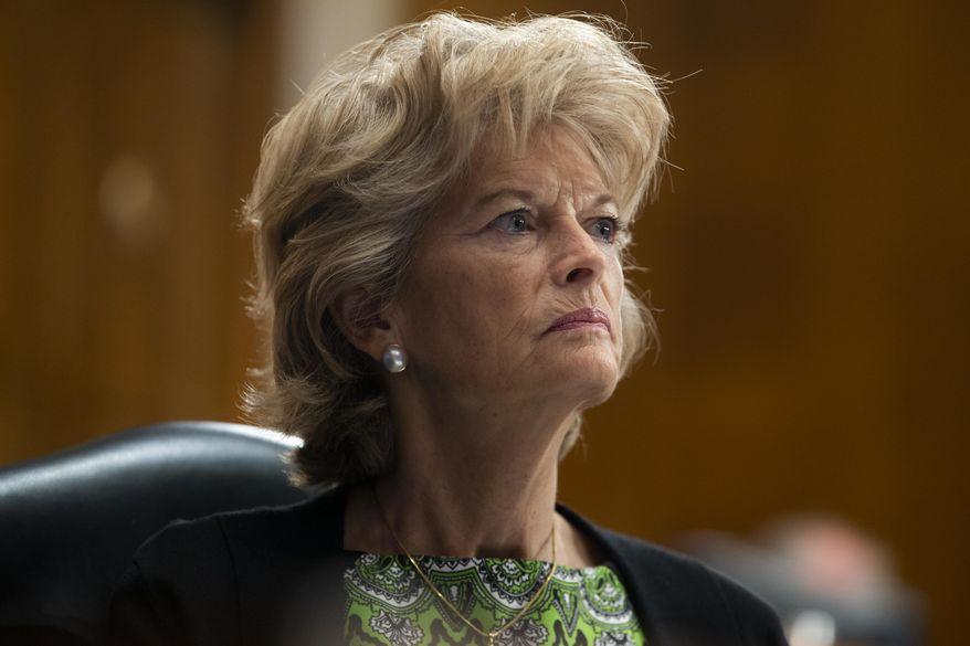 Sen. Lisa Murkowski, R-Alaska, listens during a Senate Health, Education, Labor, and Pensions Committee hearing to examine COVID-19 on Capitol Hill in Washington. (Michael Reynolds/Pool via AP, File)