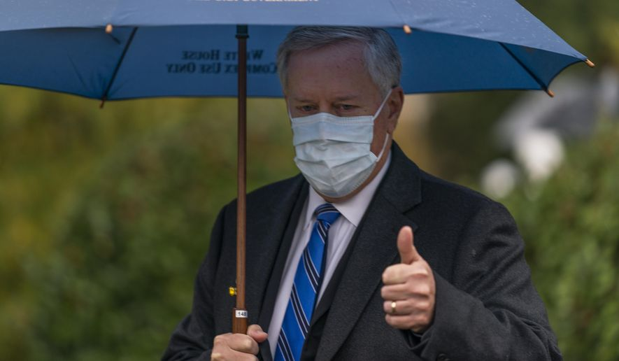 White House chief of staff Mark Meadows gestures as he responds to reporters questions outside the West Wing on the North Lawn of the White House, Sunday, Oct. 25, 2020, in Washington. (AP Photo/Manuel Balce Ceneta)
