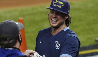 Tampa Bay Rays right fielder Brett Phillips arrives for batting practice before Game 5 of the baseball World Series against the Los Angeles Dodgers Sunday, Oct. 25, 2020, in Arlington, Texas. (AP Photo/Tony Gutierrez)