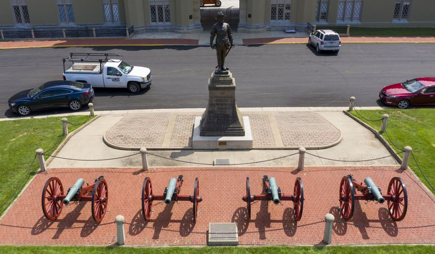 A statue of Confederate General Stonewall Jackson stands behind canons at the entrance to the barracks at Virginia Military Institute on Wednesday, July 15, 2020, in Lexington, Va. The school, founded in 1839, is the oldest state-supported military college in the United States. (AP Photo/Steve Helber) **FILE**