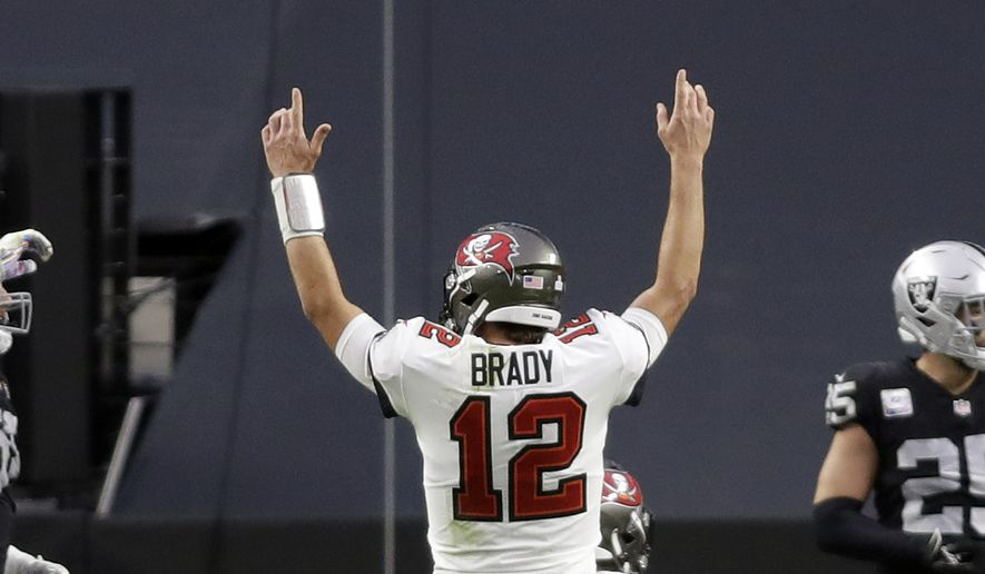 Buccaneer's quarterback Tom Brady reacts after completing a touchdown pass during the second half of an NFL football game, Sunday, Oct. 25, 2020, in Las Vegas. (AP Photo/Isaac Brekken)  **FILE**