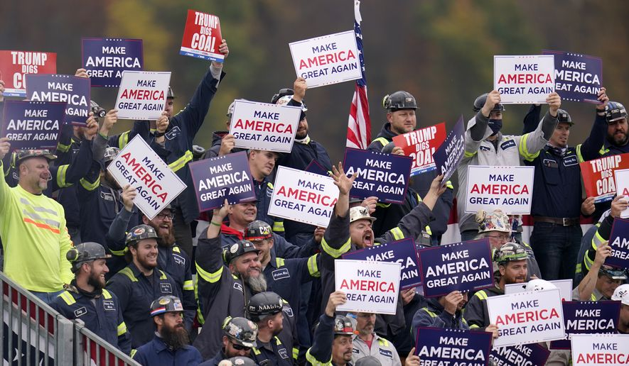 A group of Pennsylvania coal miners cheer as President Donald Trump acknowledges them during a campaign rally at the Altoona-Blair County Airport in Martinsburg, Pa, Monday, Oct. 26, 2020. (AP Photo/Gene J. Puskar)