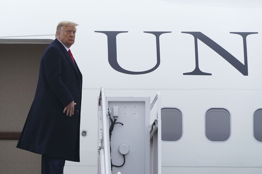 President Donald Trump pauses at the top of the steps of Air Force One at Andrews Air Force Base, Md., Monday, Oct. 26, 2020. Trump is heading to Pennsylvania for several campaign stops in the state. (AP Photo/Susan Walsh)