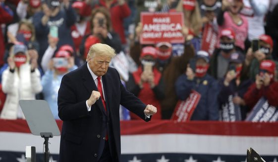President Donald Trump dances at the conclusion of a campaign rally at Lancaster Airport, Monday, Oct. 26, 2020 in Lititz, Pa. (AP Photo/Jacqueline Larma)