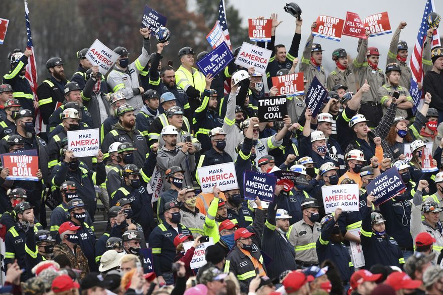 A group of Pennsylvania coal miners cheer as President Donald Trump acknowledges them during a campaign rally at the Altoona-Blair County Airport in Martinsburg, Pa, Monday, Oct. 26, 2020. (John Rucosky/The Tribune-Democrat via AP)