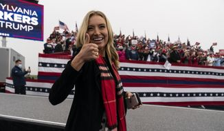 White House press secretary Kayleigh McEnany gives thumbs after President Donald Trump spoke at a campaign rally at Lancaster Airport, Monday, Oct. 26, 2020, in Lititz, Pa. (AP Photo/Alex Brandon)