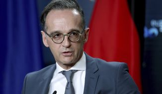 In this file photo, German Foreign Minister Heiko Maas speaks during a joint press conference as part of a meeting with Rafael Mariano Grossi, Director General of International Atomic Energy Agency (IAEA) in Berlin, Germany, Monday, Oct. 26, 2020. (AP Photo/Michael Sohn, pool)  **FILE**