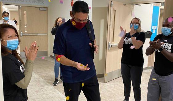 Ron Rivera celebrates his final cancer treatment Monday at the Inova Schar Cancer Institute in Virginia. (Photo courtesy of Inova)