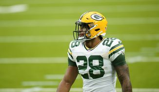 Green Bay Packers running back AJ Dillon (28) during player warmups before an NFL football game against the Houston Texans, Sunday, Oct. 11, 2020, in Houston. (AP Photo/Matt Patterson)