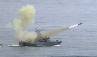 """In this May 16, 2007, file photo, a Taiwanese navy frigate launches a """"Harpoon"""" surface-to-surface missile during the second day of the annual Hankuang military exercises off Ilan, central eastern coast of Taiwan. (AP Photo/Wally Santana, File)"""