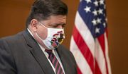 FILE - In this Sept. 21, 2020 file photo, Illinois Governor JB Pritzker appears at a news conference in Springfield, Ill. After another record-breaking day in Illinois for new coronavirus infections this weekend, Gov. J.B. Pritzker on Monday, Oct. 26, 2020, again implored residents to do all they can to prevent the spread of COVID-19, the illness caused by the untreatable virus. (Justin L. Fowler/The State Journal-Register via AP File)