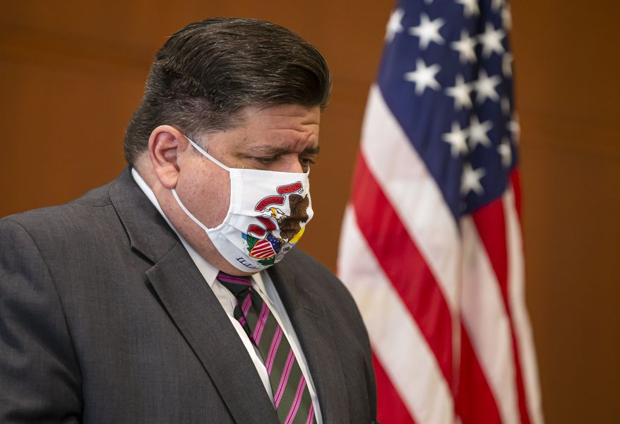 In this Sept. 21, 2020 file photo, Illinois Governor JB Pritzker appears at a news conference in Springfield, Ill. After another record-breaking day in Illinois for new coronavirus infections this weekend, Gov. J.B. Pritzker on Monday, Oct. 26, 2020, again implored residents to do all they can to prevent the spread of COVID-19, the illness caused by the untreatable virus. (Justin L. Fowler/The State Journal-Register via AP File)
