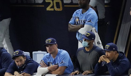 The Tampa Bay Rays watch during the ninth inning during their loss against the Los Angeles Dodgers in Game 5 of the baseball World Series Sunday, Oct. 25, 2020, in Arlington, Texas. (AP Photo/Sue Ogrocki)