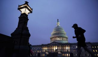 A jogger takes a early morning run at the Capitol, Monday, Oct. 26, 2020 in Washington, as Senate Republicans work toward the confirmation of Judge Amy Coney Barrett to the Supreme Court. (AP Photo/J. Scott Applewhite)