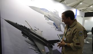 In this Feb. 5, 2020, file photo, Lockheed Martin's Robert Balserak, lead executive, Air Superiority Programs, explains the capabilities of the F-21 at the DefExpo in Lucknow, India. China's government said Monday, Oct. 26, 2020, that it will impose sanctions on U.S. military contractors including Boeing Co.'s defense unit and Lockheed Martin Corp. for supplying weapons to rival Taiwan, stepping up a feud with Washington over security and Beijing's strategic ambitions. (AP Photo/Rajesh Kumar Singh, File)
