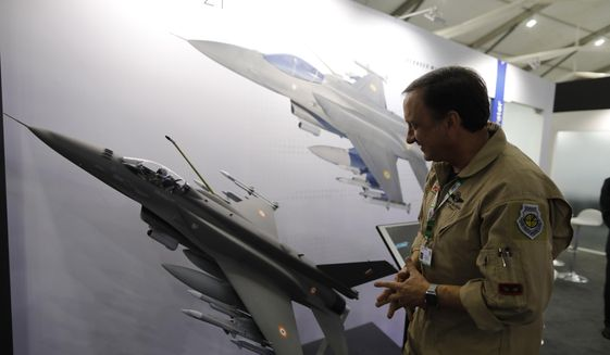 In this Feb. 5, 2020, file photo, an executive with Lockheed Martin's Air Superiority Programs explains the capabilities of the F-21 fighter jet at the DefExpo in Lucknow, India.  (AP Photo/Rajesh Kumar Singh, File) **FILE**