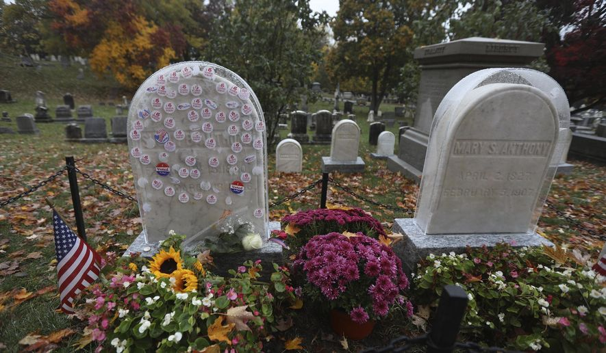 """I Voted Today"" stickers cover a protective plastic cover on the headstone of Susan B. Anthony in Mt. Hope Cemetery, Sunday Oct. 25, 2020. in Rochester, N.Y. The Friends of Mt. Hope placed plastic covers Susan and her sister's Mary Anthony's headstone as visitors have placed stickers on them since early voting started Saturday, Oct. 24. (Tina MacIntyre-Yee/Democrat & Chronicle via AP)"