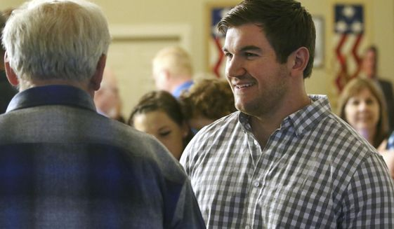 In this May 15, 2018, file photo, Alek Skarlatos, right, speaks at the Douglas County Republican Party headquarters in Roseburg, Ore. Skarlatos, who in 2015 helped thwart an attack by a gunman on a Paris-bound train, faces longtime Democratic U.S. Rep. Peter DeFazio in the November election. (Michael Sullivan/The News-Review via AP, File)