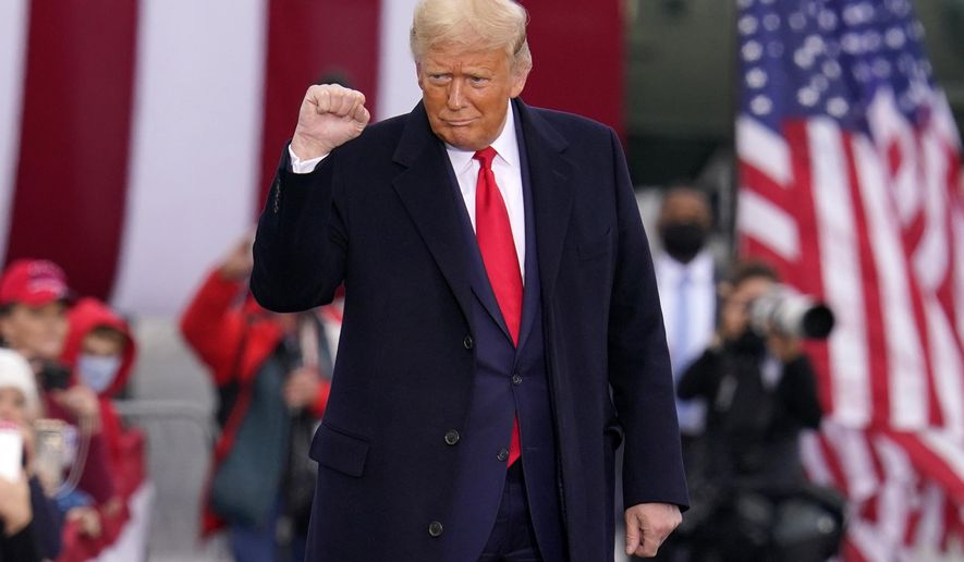 Supporters cheer as President Donald Trump arrives for a campaign rally at the Altoona-Blair County Airport in Martinsburg, Pa, Monday, Oct. 26, 2020. (AP Photo/Gene J. Puskar)