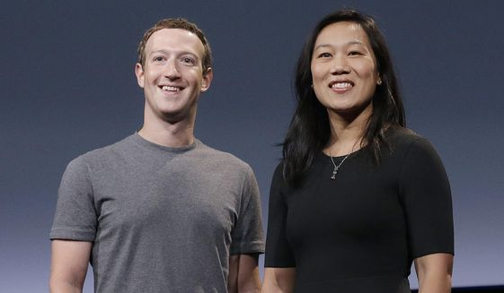 Behind a $350 million donation from Facebook CEO Mark Zuckerberg and his wife, Priscilla Chan, a nonprofit is doling out grants to Georgia state and local election officials for the Jan. 5 Senate runoffs. (AP Photo/Jeff Chiu, File)