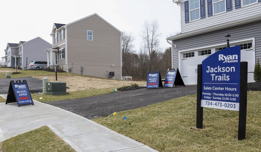 Model homes and for sale signs line the streets as construction continues at a housing plan in Zelienople, Pa., Wednesday, March 18, 2020. Sales of new homes fell by 3.5% in September to a seasonally-adjusted annual rate of 959,000 million units. The Commerce Department said Monday, Oct. 26, 2020, that despite the modest decrease, sales of new homes are up 32.1% from a year earlier, as the housing market remains strong despite the pandemic. (AP Photo/Keith Srakocic)