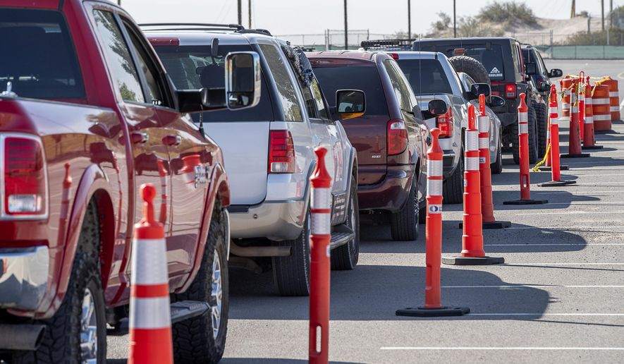 Vehicles are lined up for drive-thru COVID-19 testing in El Paso, Texas, Oct. 14, 2020. (Aaron E. Martinez/The El Paso Times via AP)
