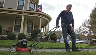 James Musgrave, 61, discusses the increase in cases of the coronavirus in West Union, W.Va., Wednesday Oct. 21, 2020. (AP Photo/Kathleen Batten)