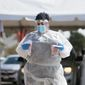 Hospital officials are pleading with the public to mitigate the spread of the coronavirus, or surgeries will be paused and drastic measures may occur. (ASSOCIATED PRESS)