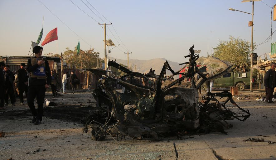 Afghans check aftermath of a car bomb explosion in Kabul, Afghanistan,Tuesday, Oct. 27, 2020. (AP Photo/Mariam Zuhaib)