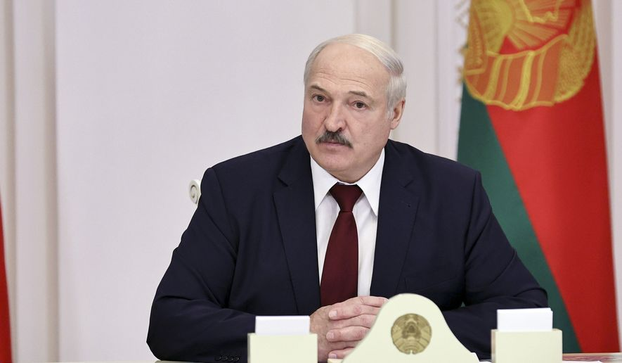Belarusian President Alexander Lukashenko attends a meeting in Minsk, Belarus, Tuesday, Oct. 27, 2020. (Nikolai Petrov/BelTA Pool Photo via AP)
