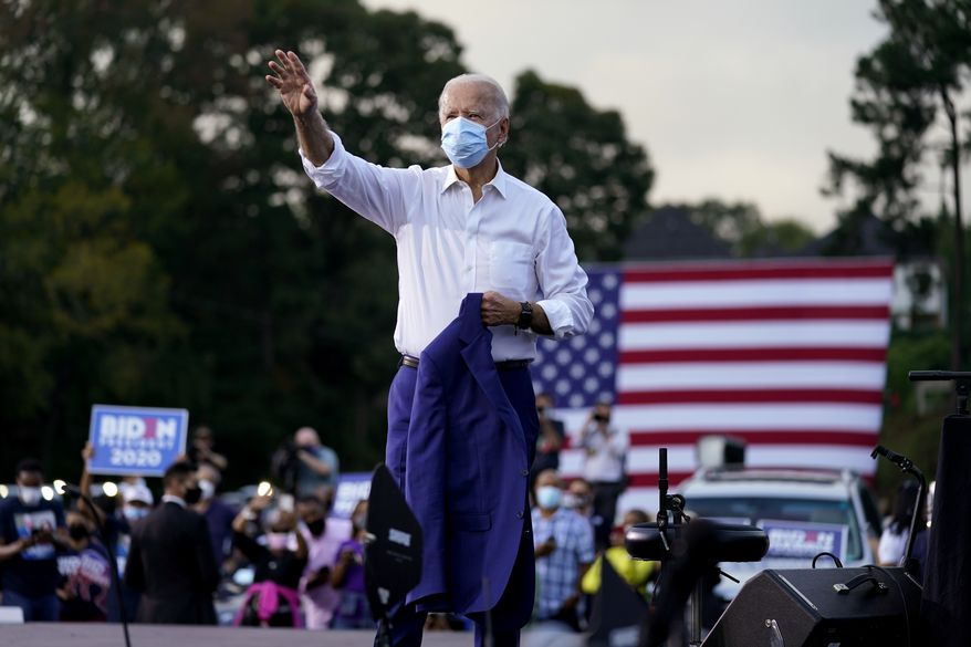 Democratic presidential candidate former Vice President Joe Biden greets supporters during a drive-in rally at Cellairis Amphitheatre in Lakewood, Ga., Tuesday, Oct. 27, 2020. (AP Photo/Andrew Harnik)
