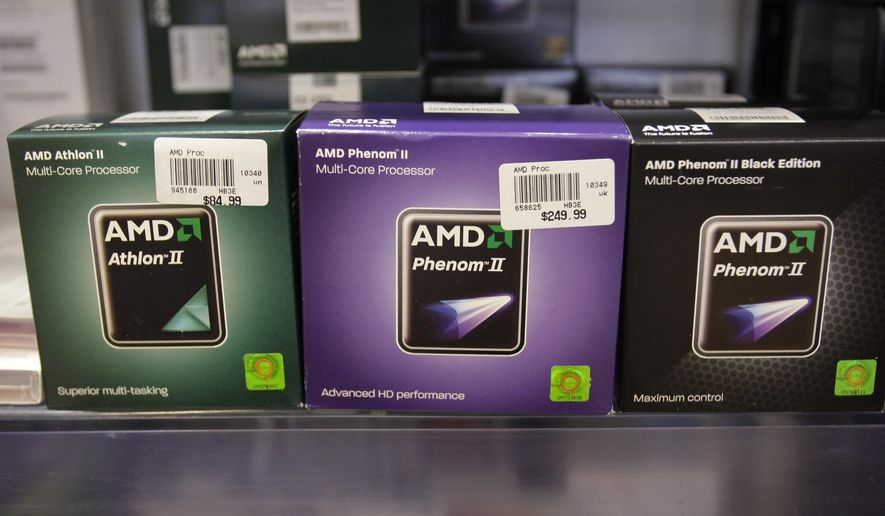 FILE - In this Jan. 20, 2011, file photo, AMD chips are displayed at the Micro Center computer store in Santa Clara, Calif. AMD is buying processing platform developer Xilinx in an all-stock deal valued at $35 billion. (AP Photo/Paul Sakuma, File)