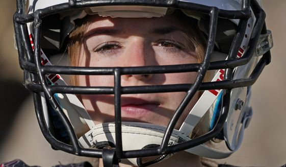 Sam Gordon poses for a photograph, Oct. 20, 2020, in Herriman, Utah. Gordon was the only girl in a tackle football league when she started playing the game at age 9. Now, Gordon hopes she can give girls a chance to play on female-only high school teams through a lawsuit. (AP Photo/Rick Bowmer)  **FILE**